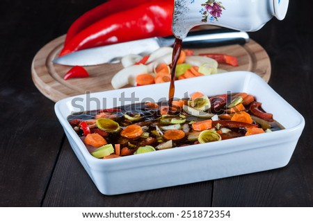 meat in soy sauce with vegetables - prepare the marinade - stock photo