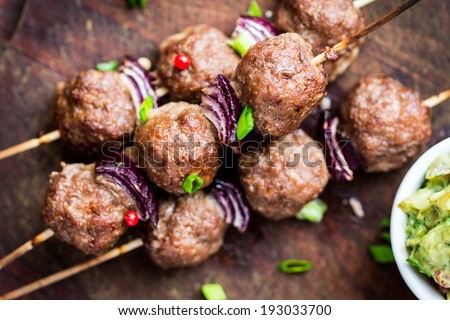 Meat kebab, beef balls on skewer with onions, avocado sauce guacamole, spring picnic - stock photo