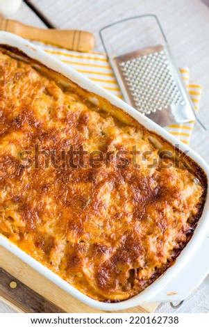 meat lasagna with mushrooms on a white background ,Italian cuisine