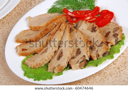 Meat loaf with lettuce on white plate