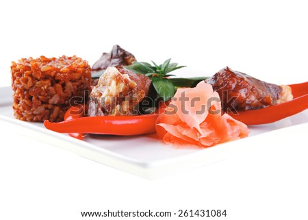 meat main course served on white plate over white - stock photo