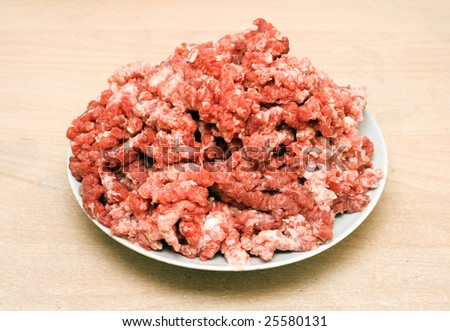Meat mincemeat in plate - stock photo