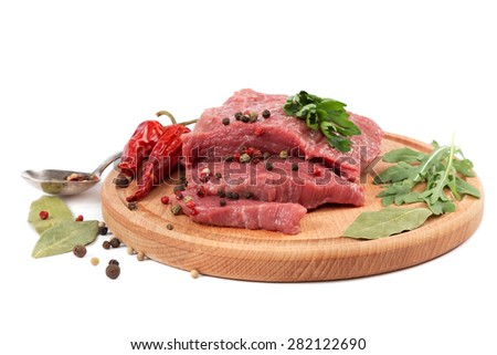 Meat on a cutting board isolated on white background. - stock photo
