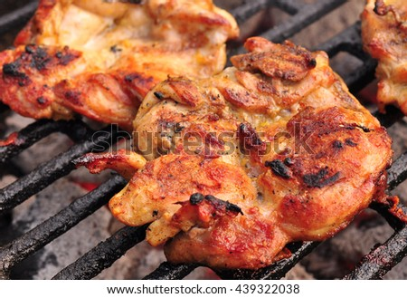 Meat on grill grilling steak - stock photo