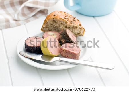 meat pate with different flavors on white table - stock photo
