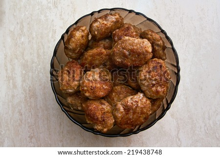 Meat patties in the plate on the table - stock photo