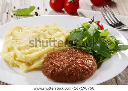 meat patty on a plate - stock photo