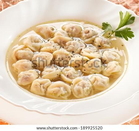 Meat pelmeni with sour cream. Selective focus - stock photo