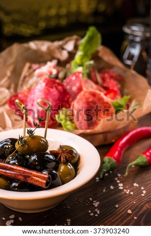 meat plate and olives - stock photo
