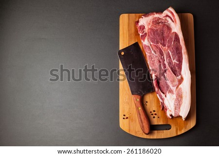 Meat pork fresh. Raw meat on cutting board. Spice and meat. Axe and meat pig. Fat piece - stock photo