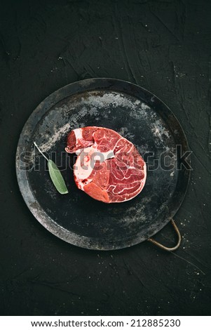 Meat. Raw meat beef steak on black with herbs - stock photo