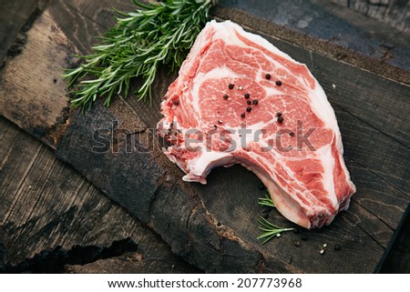 Meat. Raw rump steak on wood with herbs - stock photo