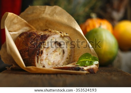 meat roll in parchment on wooden table