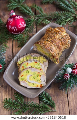 Meat roll stuffed with green peas and bell peppers - stock photo