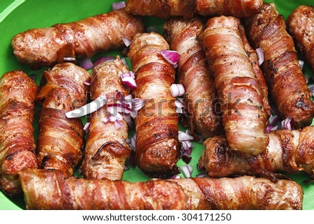 meat rolled with bacon - stock photo