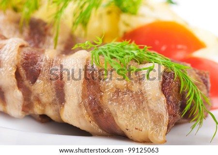 Meat rolls and tomatoes with fennel and potatoes