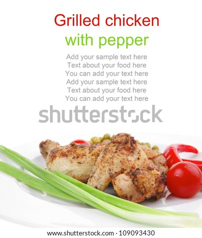 meat savory : chicken legs  grilled and garnished with green onion and red chili hot pepper on white plate isolated over white background - stock photo