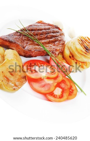 meat savory : grilled beef fillet steak on white plate with tomatoes , potatoes and chives isolated over white background - stock photo