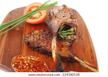 Meat Savory On Wooden Plate Roast Ribs With Peppers Tomato And Dry Spices Isolated On