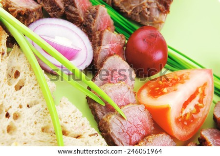 meat savory : roasted bbq meat served on green plate with tomatoes and sprouts isolated on white background - stock photo