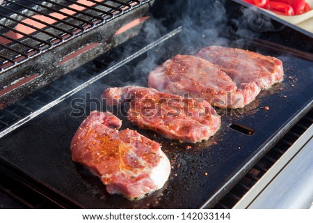 Meat  sizzling on the BBQ - stock photo