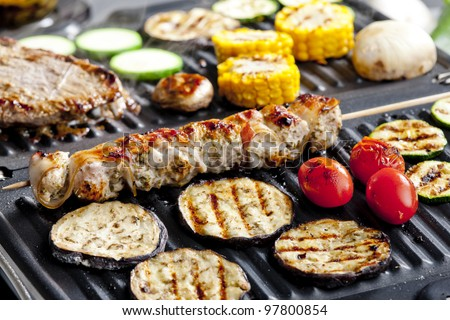 meat skewer and vegetables on electric grill - stock photo