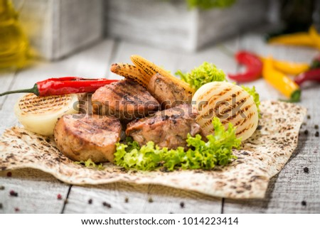 meat skewers on the grill, Tasty and healthy food on a plate