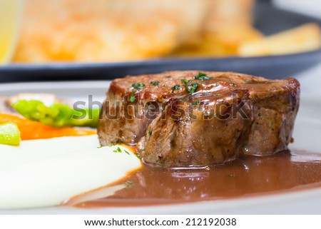 Meat Steak with brown sauce - stock photo