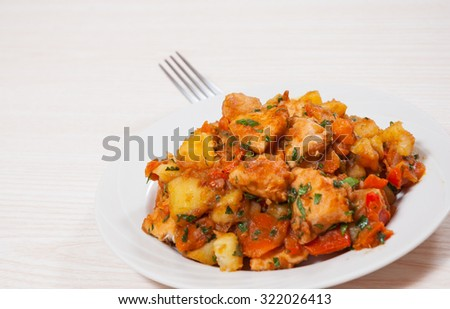 meat stew with potatoes, pepper, onion and carrot