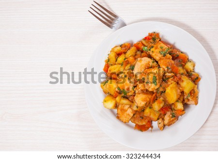 meat stew with potatoes, pepper, onion and carrot - stock photo