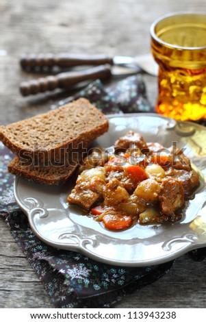 meat stewed in beer - stock photo