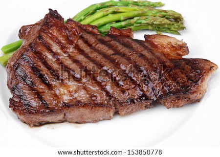 meat table : grilled beef fillet with asparagus on white dish