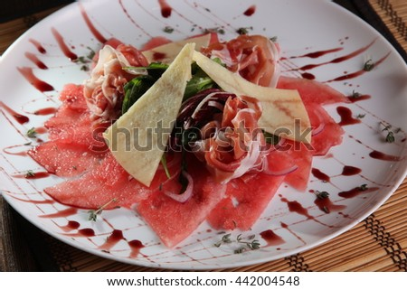 meat with cheese and watermelon on plate