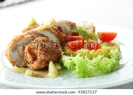 meat with garnish on white dish - stock photo