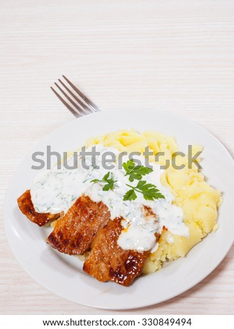 meat with mashed potatoes and sauce - stock photo