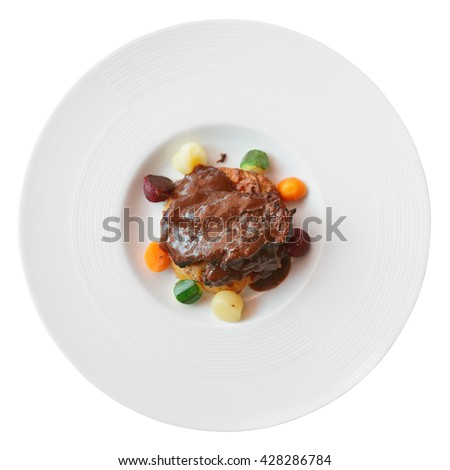 Meat with pepper sauce shot from above, isolated on white background - stock photo