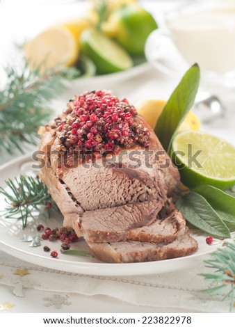 Meat with pink pepper for Holiday dinner, selective focus  - stock photo