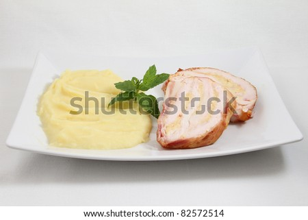 meat with potato on white plate isolated on white background - stock photo