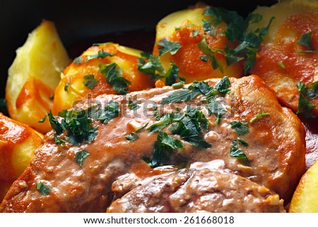 Meat with tomato sauce baked with potatoes - stock photo