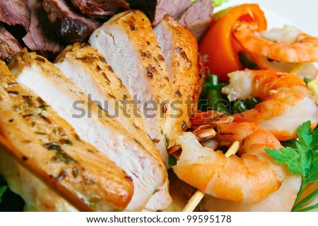 meat with vegetables and shrimps - stock photo