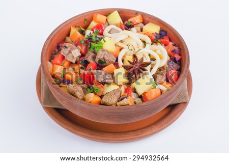 meat with vegetables carrots potatoes in a pot with cardamom on a white background isolation - stock photo