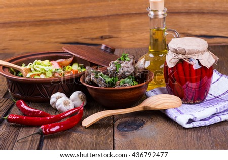 meat with vegetables on a wooden background
