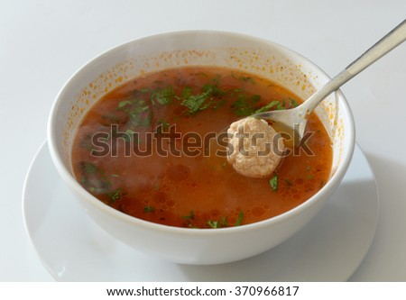 meatball soup with  tomato sauce and parsley
