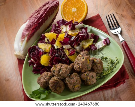 meatball with red chicory and orange salad - stock photo