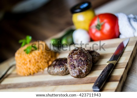 meatball with rice bulghur, vegetables and mustard
