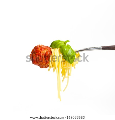 Meatball with spaghetti and basil on a fork