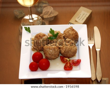 meatballs in onion sauce whit cherry - stock photo