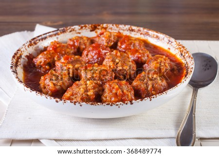 meatballs in tomato sauce in a bowl on a table, selective focus