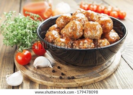 Meatballs in tomato sauce in the bowl - stock photo