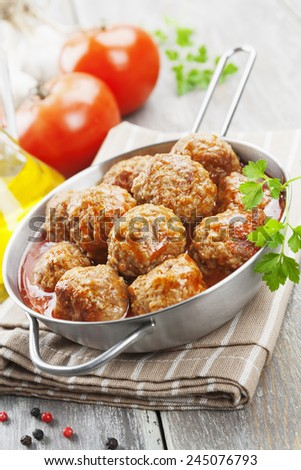 Meatballs in tomato sauce in the pan